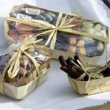 Tirinhas de laranja e chocolate em cestas de madeira Tom pouce